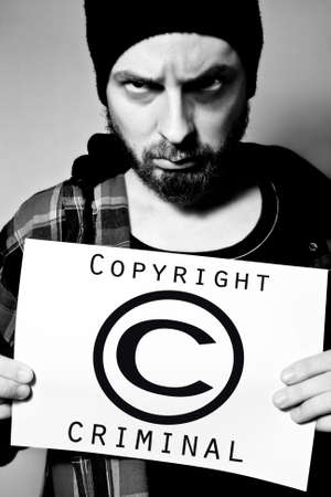 Man arrested for violating copyright laws Stock Photo - 3836621
