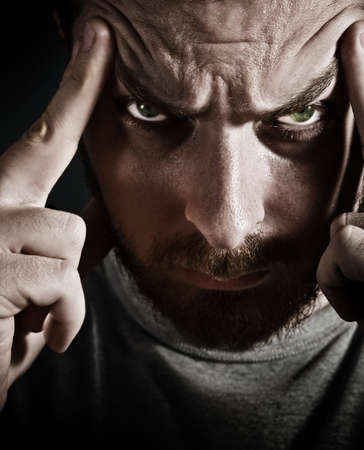 Close-up portrait of scary man looking very stressed and upset  photo