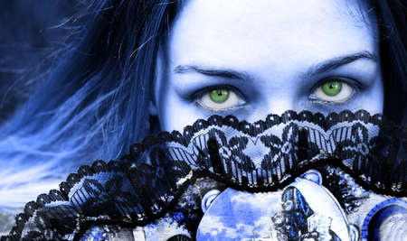 Gothic woman with mysterious green eyes photo