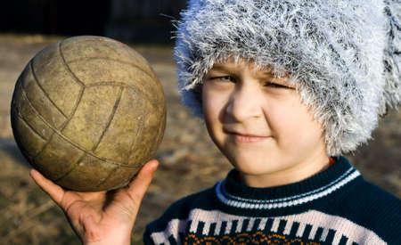 needy: Needy cute boy with warn ball in his hand