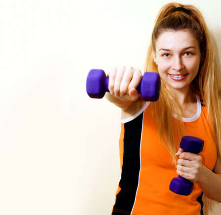 Woman working out with dumbbells on white background Stock Photo