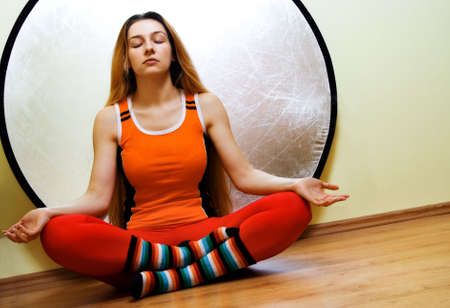 Yoga: woman relaxing in lotus position Stock Photo - 3861442