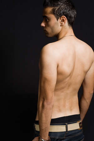 Back of masculine sexy man in a low key ambience Stock Photo - 3960473
