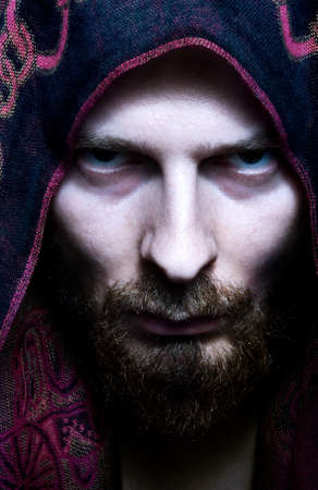 Portrait of mysterious scary man with evil look on his face Stock Photo - 3970184