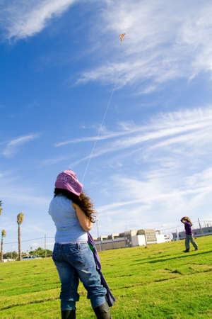 Girls playing with kite in a Tel Aviv park, Israel Stock Photo - 3978936
