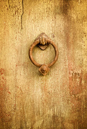 Vintage grungy image of ancient door knocker photo