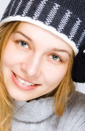 Winter portrait: closeup on young woman with beautiful green eyes photo