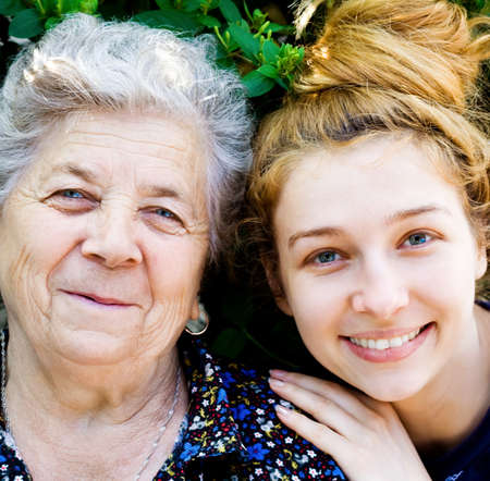 Closeup portrait of happy grandmother and grand daughter photo