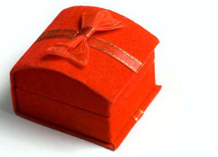 closed ribbon: Macro shot of red present box with ribbon