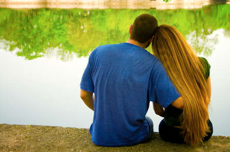 Vibrant image of two lovers on lakeside photo