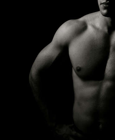 pectorals: Low-key image of muscular masculine man