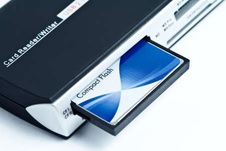 Card reader with compact flash inside on white background photo