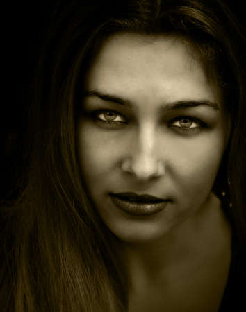 Vintage closeup portrait of woman with beautiful eyes photo
