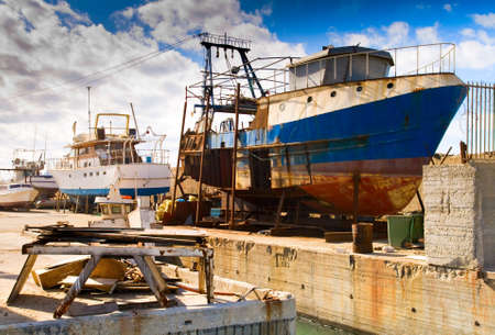 Rusty stationary ship on dockyard Stock Photo - 4166341