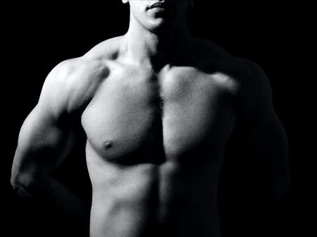 muscular male: Muscular male torso on black background Stock Photo