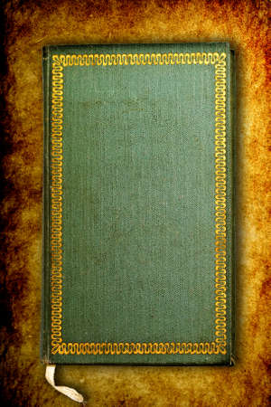 Ancient worn book on grungy burnt background Stock Photo - 4225418