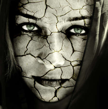 Global warming concept: face of woman with cracked skin photo