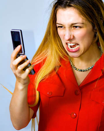 Angry stressed businesswoman screaming at the phone Stock Photo - 4205003