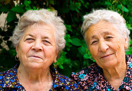 Outdoor portrait of two old ladies