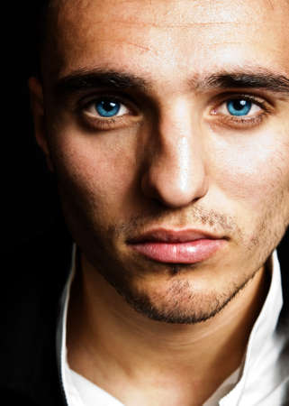Closeup portrait of sensual man with blue eyes photo