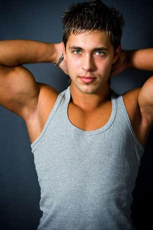 armpits: Studio portrait of muscular handsome man