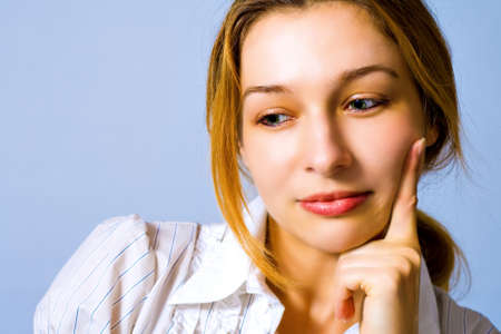 Portrait of pensive beautiful young woman photo