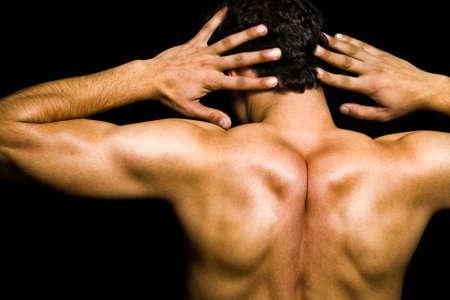 head and shoulder: Artistic pose - back of muscular man over black