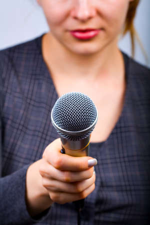 Reporter with microphone taking interview or opinion poll Stock Photo - 4301245