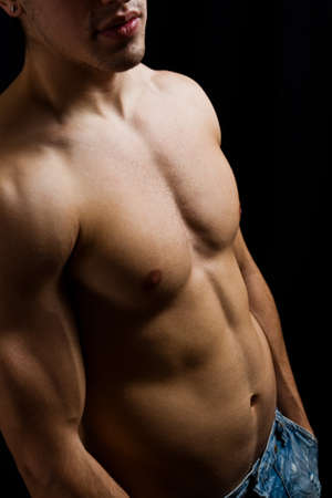 pectorals: Fine art portrait of muscular male bodybuilder