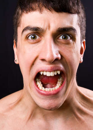 Scream of shocked and scared young man photo