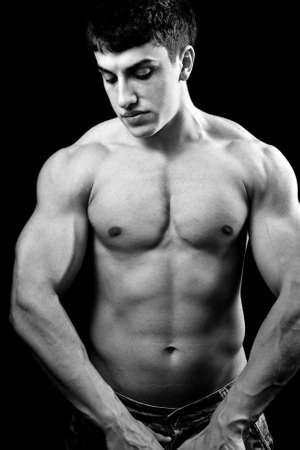 male muscles muscular pecs pectoral sexy young: Portrait of big muscular sexy young bodybuilder