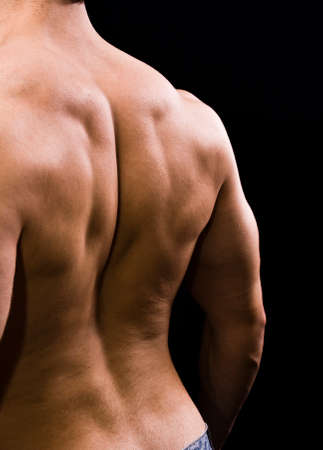 Man with big muscular back on black background Stock Photo - 4405334