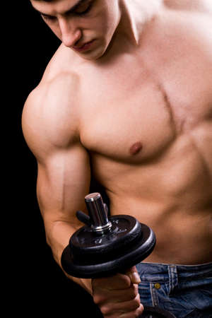 pectorals: Bodybuilder in action - muscular powerful man lifting metal weights