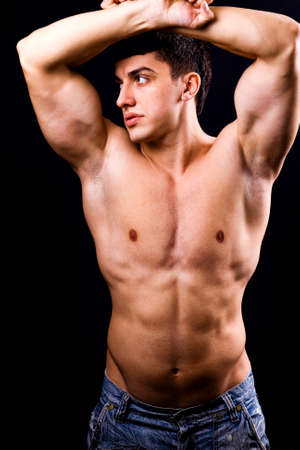 sexy muscular man: Portrait of sexy muscular man with fit body Stock Photo