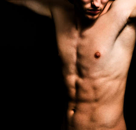 Artistic image of muscular sexy man body over black Stock Photo - 4579172