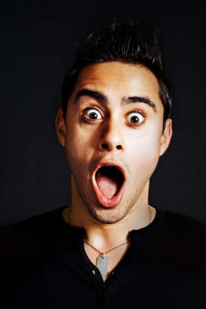 shocked: Surprise concept - portrait of amazed funny man Stock Photo