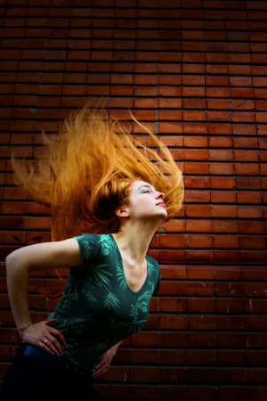 Grunge fashion portrait of woman with motion hair photo