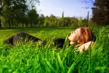 Carefree concept - young woman relaxing outdoor Stock Photo
