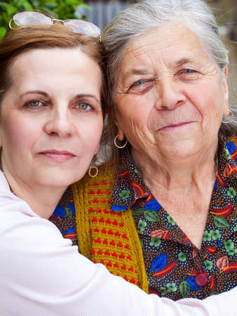 Family portrait - happy senior mother and daughter photo