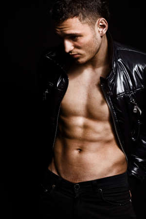 Fashion shot of muscular sexy handsome young man Stock Photo