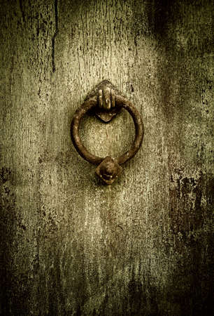 front entry: Grunge medieval background - rusty antique door knocker Stock Photo