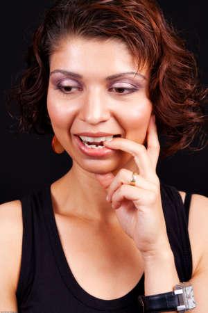 Idea concept - pensive happy indian female Stock Photo - 5034612