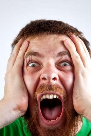 berros: Concepto ganar - grito asombrado de hombres felices Foto de archivo