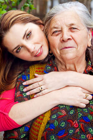 Family - happy young woman with her grandmother Stock Photo - 5070953