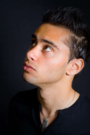 close up: One young man looking up