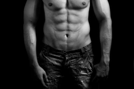 male muscles muscular pecs pectoral sexy young: Torso of muscular man with nice abdomen over black