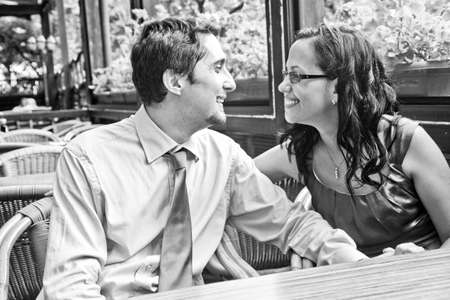 Happy carefree couple laughing at restaurant table photo