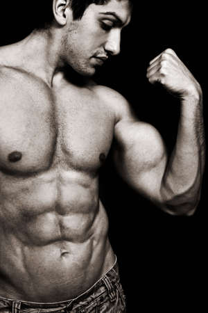 muscular body: Portrait of sexy muscular man showing his biceps Stock Photo