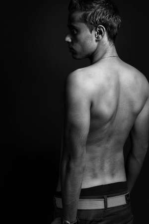 Back of masculine sexy shirtless thin man photo