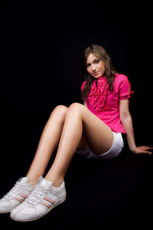 short shorts: Cute female teen with long legs and sport shoes
